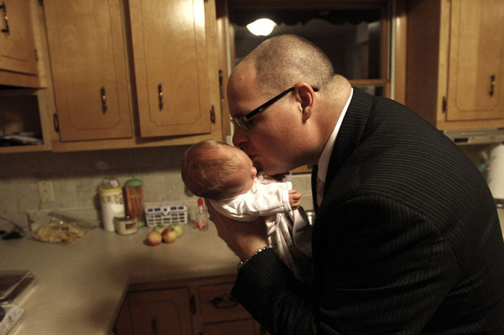 Anslee Tipton, 13 days old, captures her father's attention.