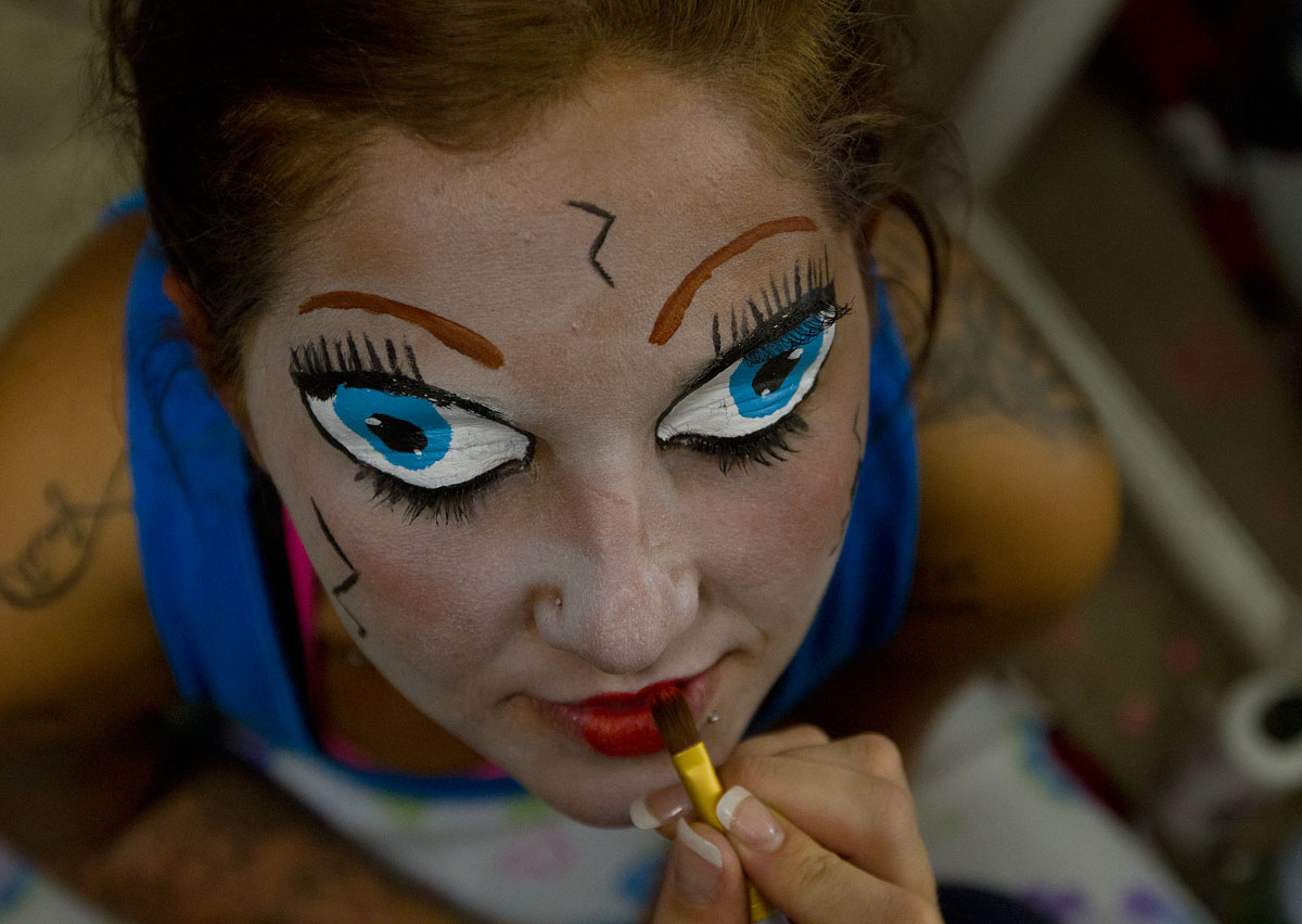 Brittnee Dailey of Bowling Green has makeup put on by Brittany Cline before the opening of The Apocalypse Haunted Attraction at 1210 Church Street Friday. Cline's husband, Sammy Martin, opened the haunted house for the first time this year. He and his children live for Halloween, Cline said.