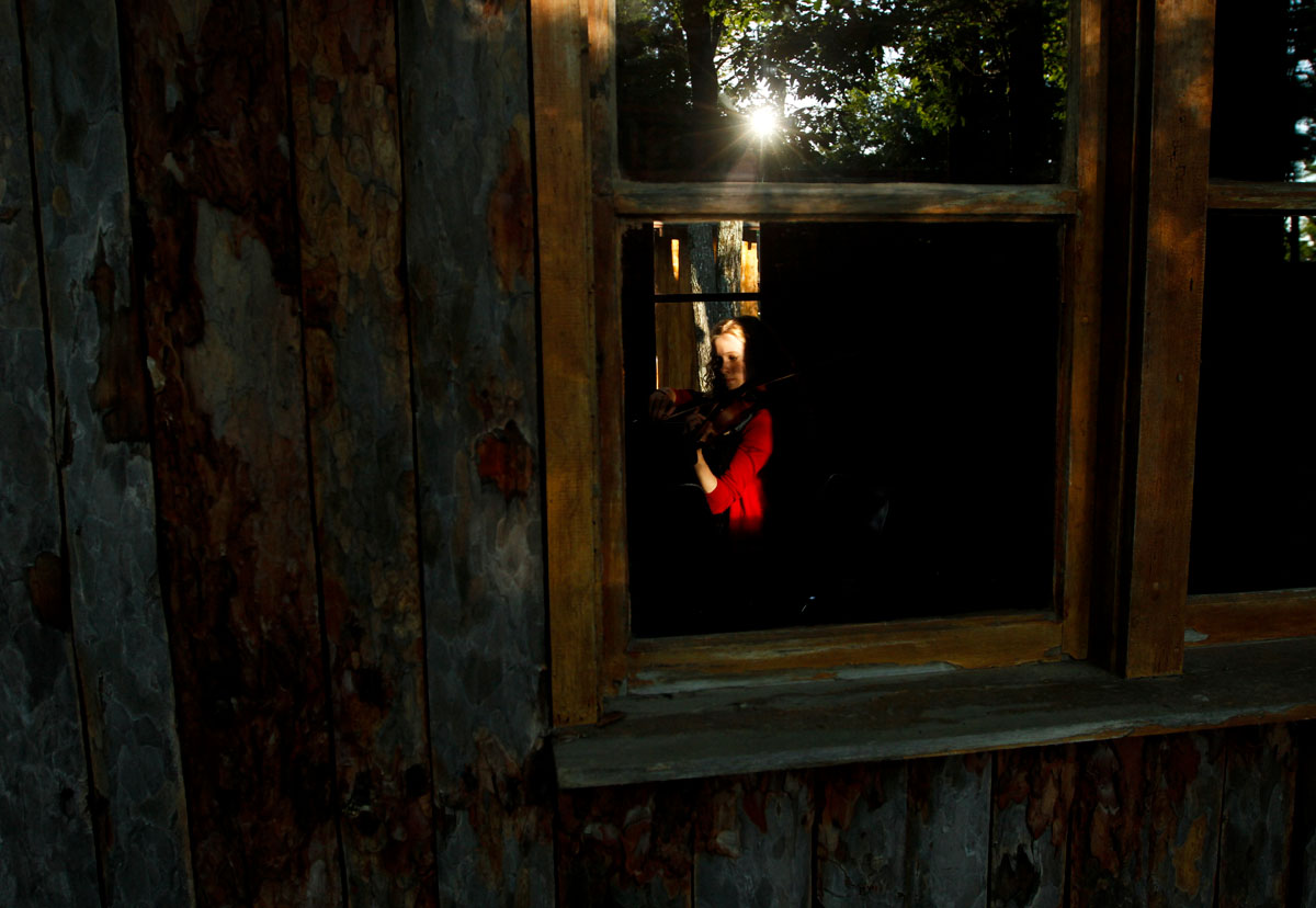 A student musician rehearses in a practice hut during her evening free time at Interlochen Arts Camp in northern Michigan. Now in its 83rd year, the camp is attended by around 2,500 students between the ages of eight and 18 for two, three or six week stints.