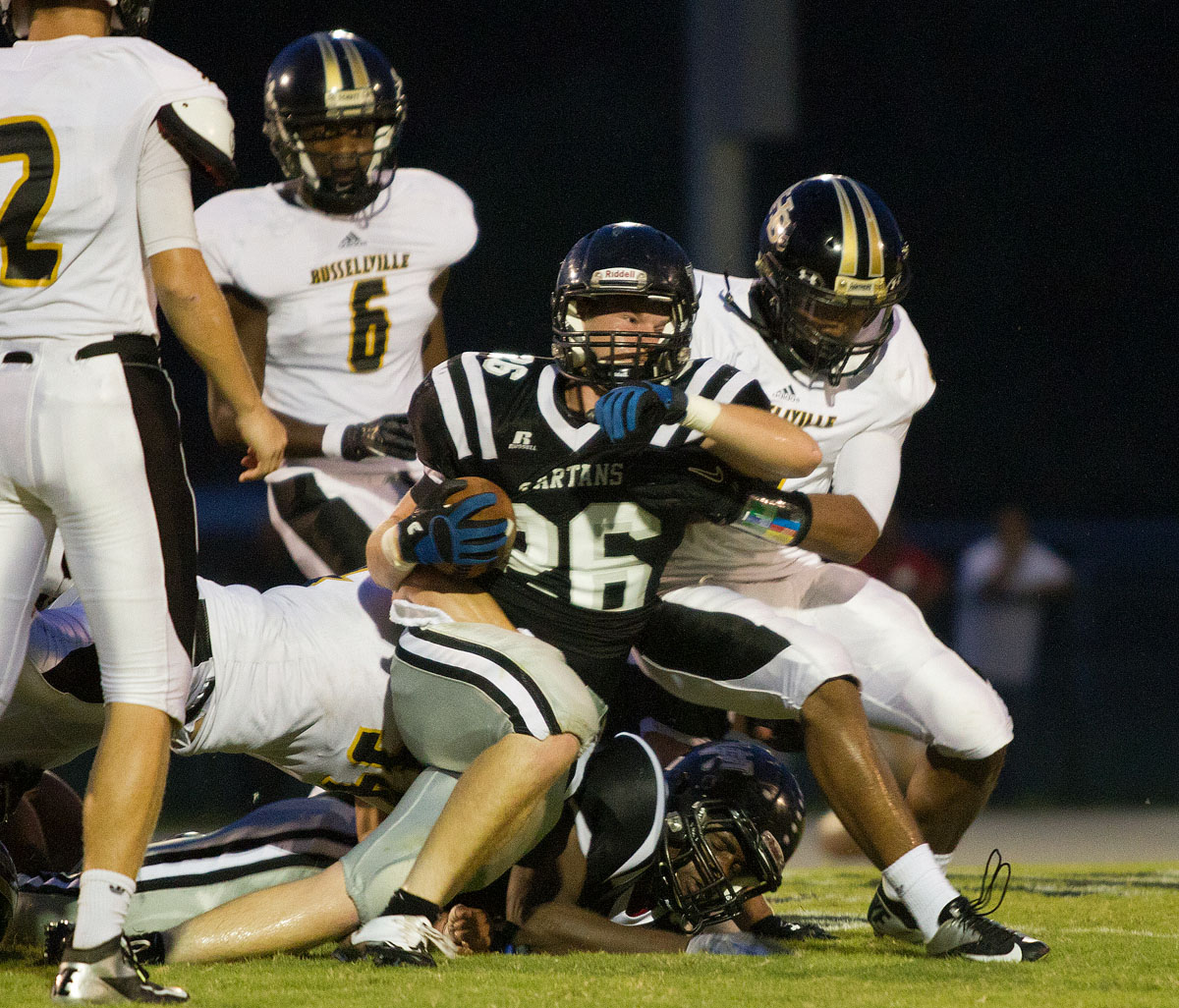 South Warren junior Drew Wilken is pulled down with the ball during a game between South Warren and Russellville Sept. 7 at South Warren High School. South Warren beat Russellville 20-0.