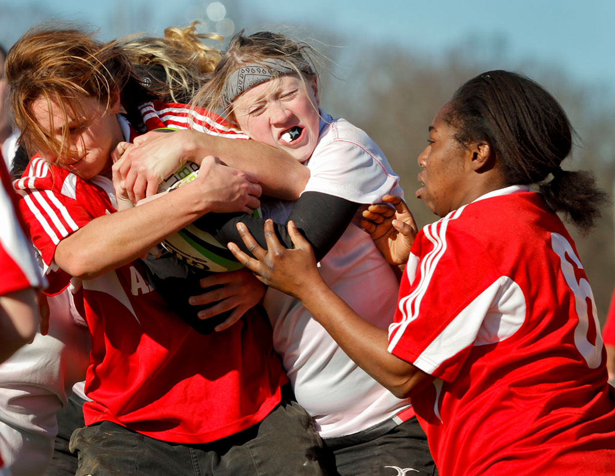 Christina Bradley fights for the ball during the Women's Club Rugby Team's 10-69 loss to the University of Alabama Saturday at the Preston Intramural Complex.