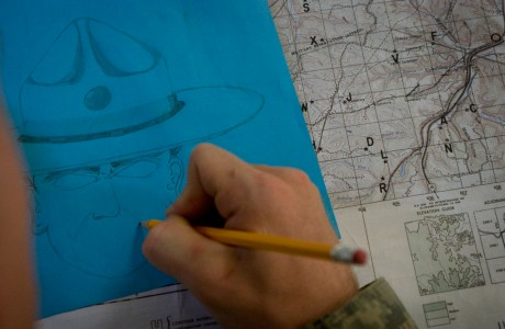While sitting through a day of map reading classes in preparation for a forest land navigation test, a cadet draws a caricature of a drill sergeant to pass the time. Roughly 1,500 college students go through 29 days of training at Fort Knox, Ky., each summer before joining the Army ROTC programs at their schools. The sixth of seven companies to go through training in 2010, Co. A 2/321st IET, made up of roughly 200 cadets, was at Fort Knox from July 6 to Aug. 3.