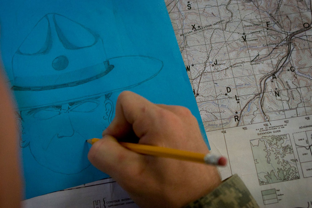 While sitting through a day of map reading classes in preparation for a forest land navigation test, a cadet draws a caricature of a drill sergeant to pass the time. Roughly 1,500 college students go through 29 days of training at Fort Knox, Ky., each summer before joining the Army ROTC programs at their schools. The sixth of seven companies to go through training in 2010, Co. A 2/321st IET, made up of roughly 200 cadets, was at Fort Knox from July 6 to Aug. 3, 2010.