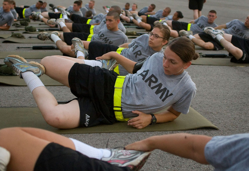 After taking a run in preparation for a physical training test, cadets stretch together. Cadets woke up at 5 a.m. most days and usually began training by 5:30.