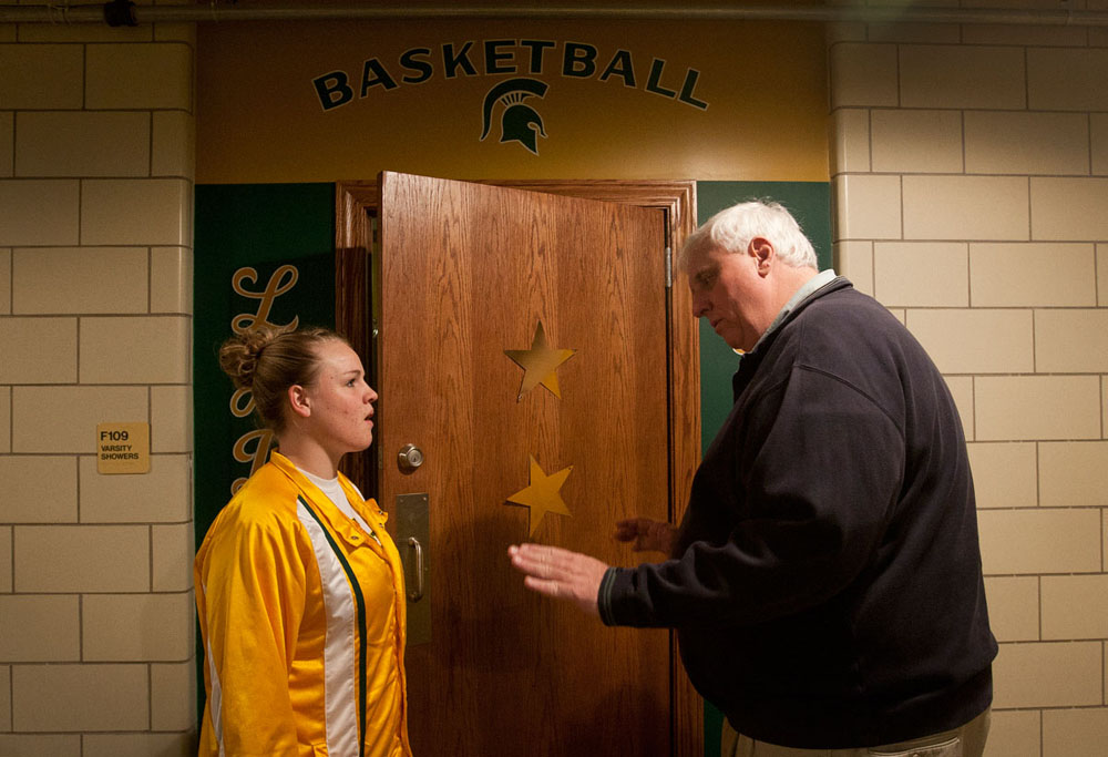 Outside the locker room he paid to remodel, Head Coach Jim Justice calms sophomore Maddee Carroll before a state-sendoff pep rally Wednesday at Greenbrier East High School. Justice, 59, owns the Greenbrier Resort and 47 other businesses and began coaching the Lady Spartans when his daughter was on the team.