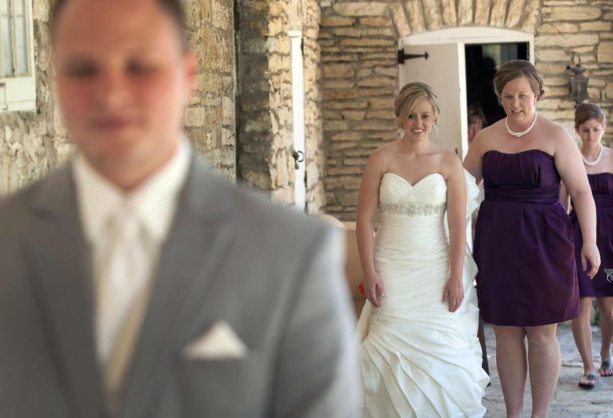 Accompanied by her maid of honor, Beth, Kari walks out to see Brandon for the first time on their wedding day.
