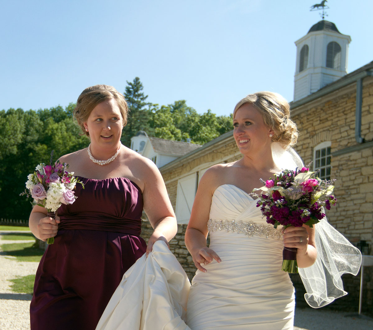 Kari and Beth walk to the ceremony area at Mayowood Stone Barn.