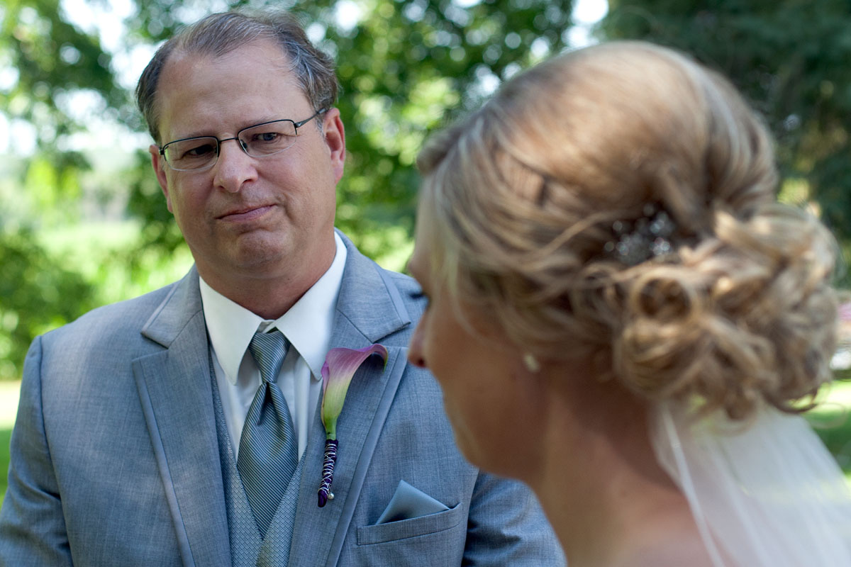 Dean waits with Kari before walking her down the aisle.