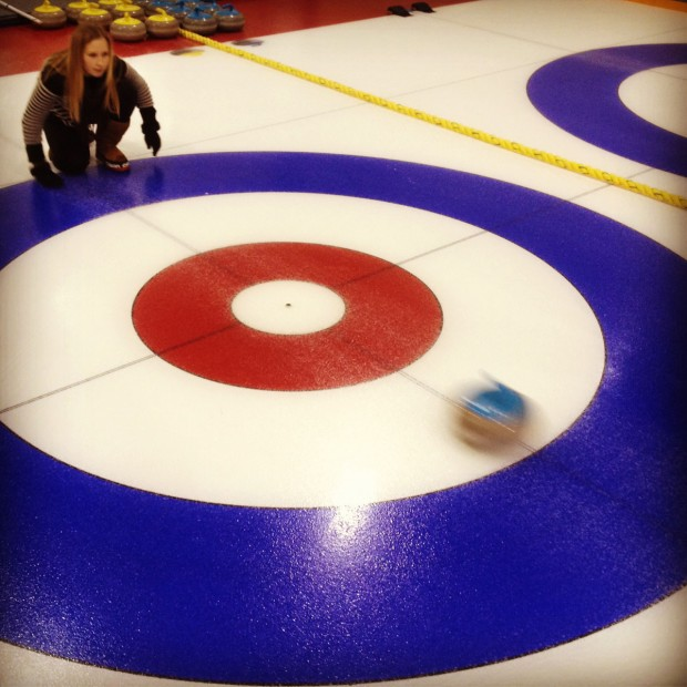 Curling with assistant picture editor Abby during a trip to visit our printer in Canada.