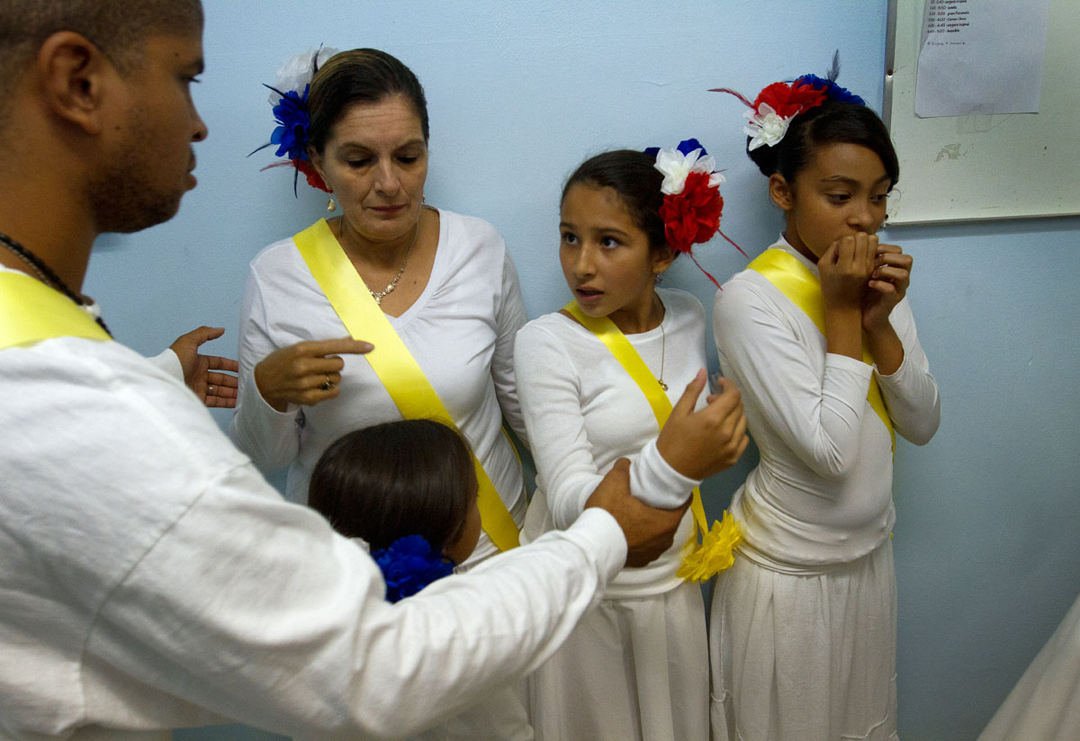 Liturgical dancers from Holy Apostles Church in Rochester line up before performing in a talent show to celebrate Hispanic Heritage Month Sept. 22.