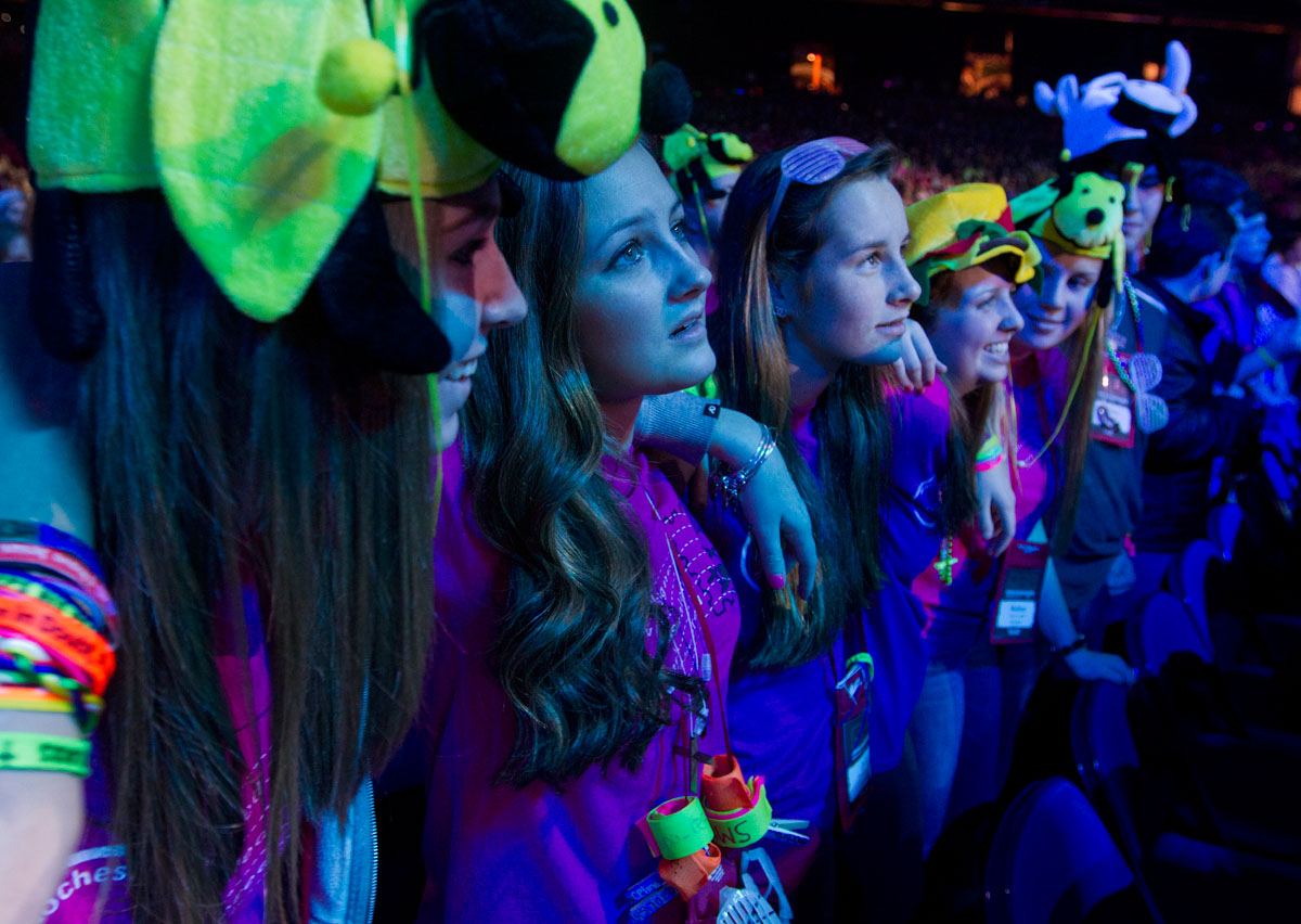 "(left to right) Jenna Brooks, Celina Rescott, Judy Rescott, Maggie Flurschutz and Mallory Colella dance and sing-along to ""By the Love of God,"" the 2013 theme song for the National Catholic Youth Conference at the end of NCYC's opening ceremony Nov. 21 at Lucas Oil Stadium in Indianapolis."
