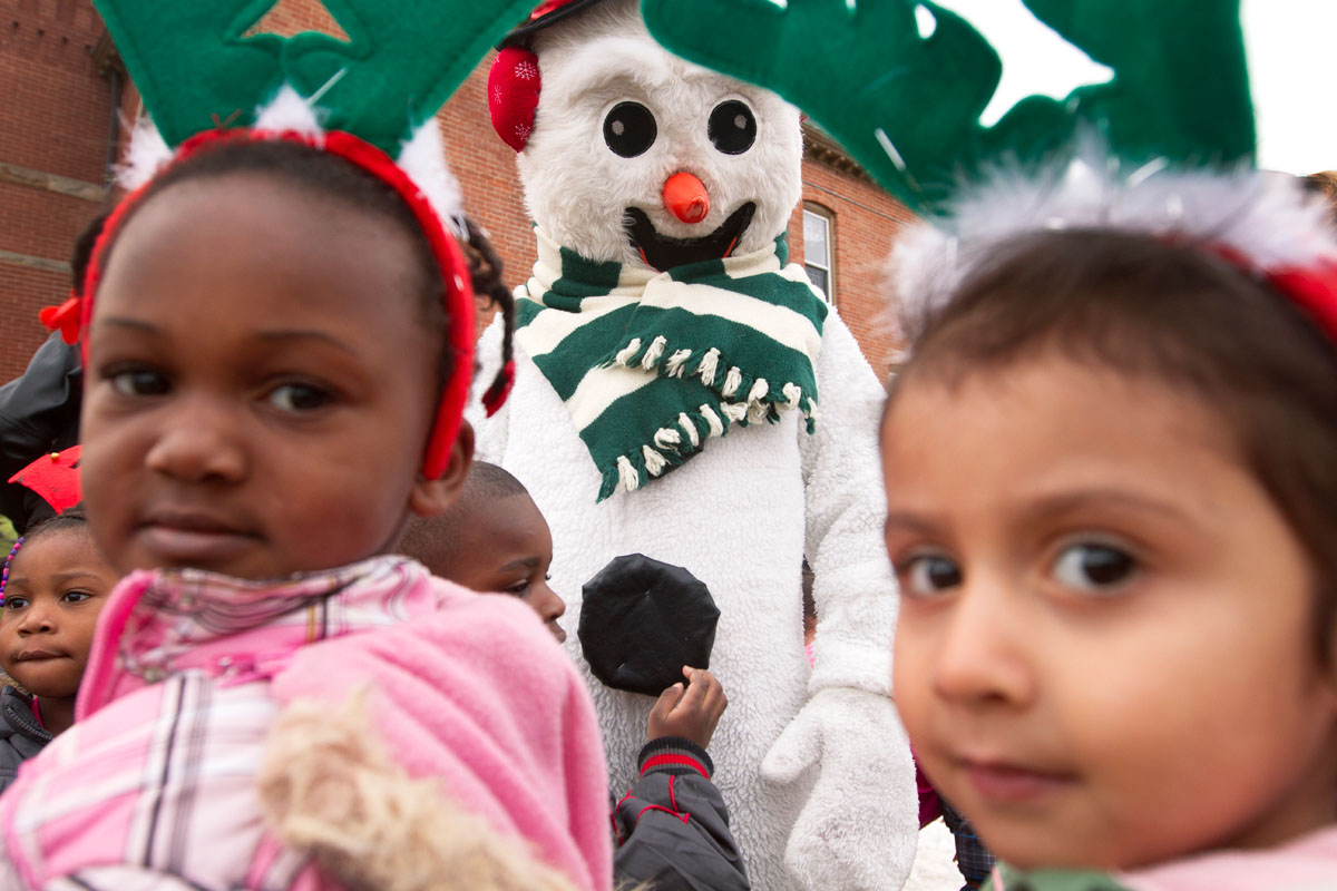 Frosty joins Santa, Rudolph the Red-Nosed Reindeer and local politicians for an annual tree-lighting ceremony outside St. Michael Church in Rochester Dec. 5. Children from a nearby child-care center and students from Schools 9 and 20 were also in the audience.
