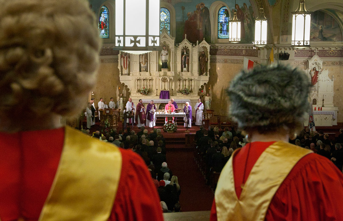 Choir members watch as Bishop Emeritus Matthew H. Clark celebrates the eucharist during Mass at St. Stanislaus Kostka Church in Rochester Dec. 15. Built in 1909, the church has a Polish heritage.