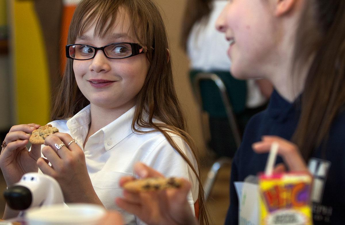 Fifth-grader Bohdana Collpelnic listens to classmate Krysha Pierce during Special Person's day at St. Joseph School in Auburn Jan. 30.
