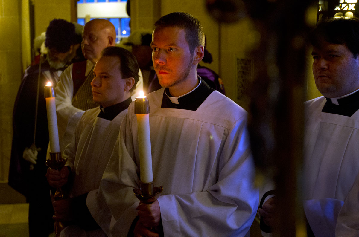 Seminarians, Camilo Aguilar, left, Justin Miller and David Fiorito wait to process in from the back of Sacred Heart Cathedral at the Chrism Mass April 15.