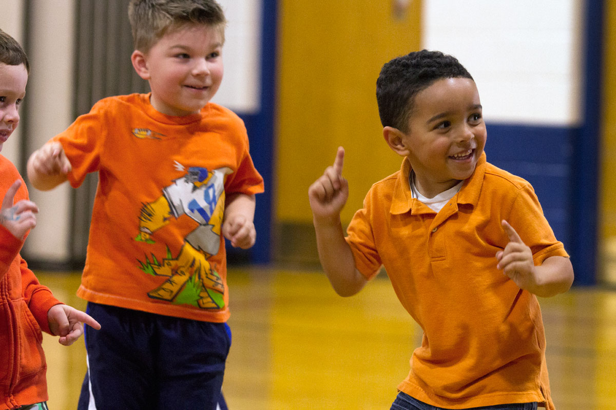 "Preschoolers Daniel Wright (left) and Roman Maldonado dance to the ""Hokey Pokey"" with classmates. Students at St. Kateri School in Irondequoit showed support for former student Avrie Sinesiou by shooting a music video and holding a dress-down day May 14."