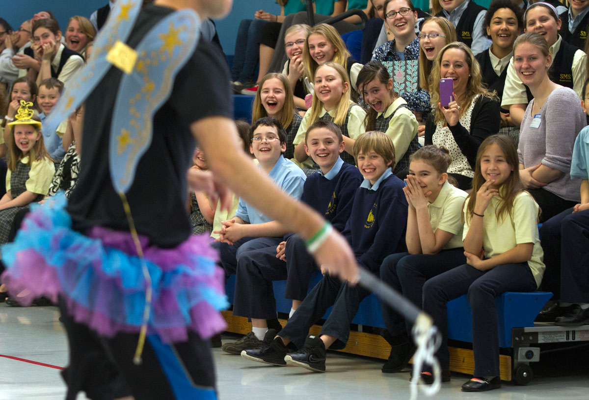 Students react as technology teacher Dan Pitnell comes out dressed in a tutu during a school assembly April 11 at St. Mary School in Canandaigua.