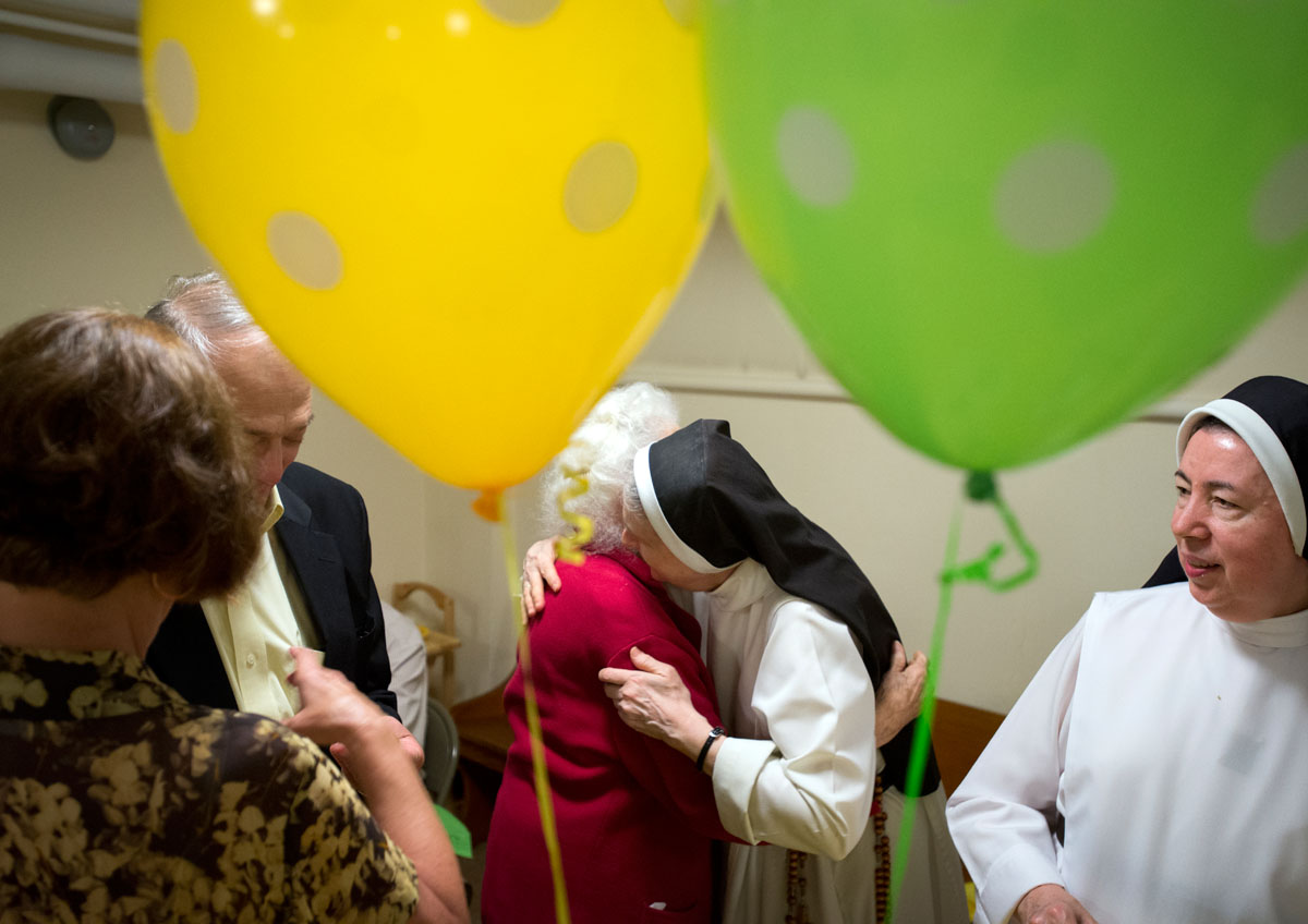 Sister Ritamae Dillon hugs Margaret Amisano during a luncheon to celebrate the 70th anniversary of the Dominican  Monastery of Mary the Queen in Elmira Aug. 16. The 15 religious sisters living in the monastery moved to Illinois Sept. 2.