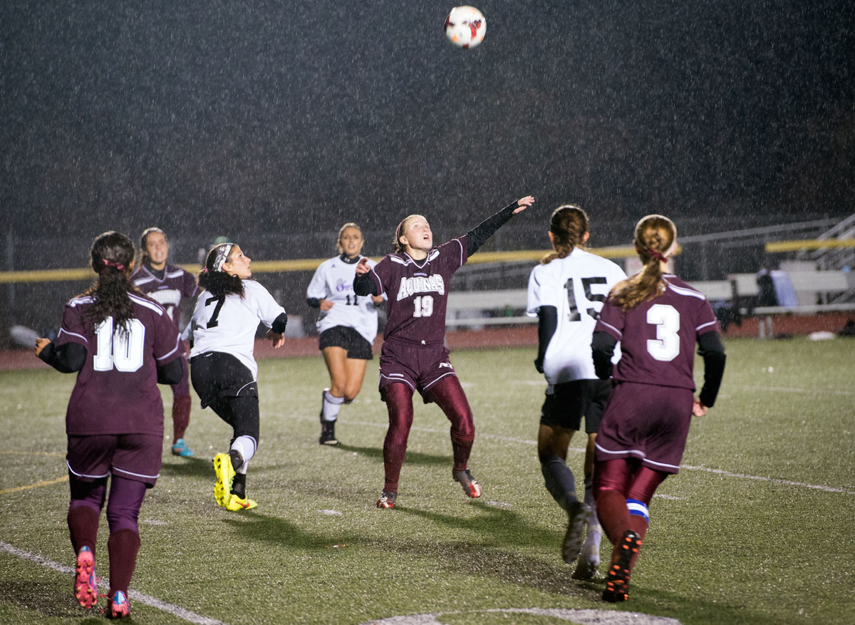 Aquinas sophomore Lauren Begy (19) prepares to head the ball during the second half of the Section V Class B championship Oct. 31 at Caledonia-Mumford Central School in Caledonia. After four overtime periods, Aquinas won a penalty-kick shootout to advance to State.