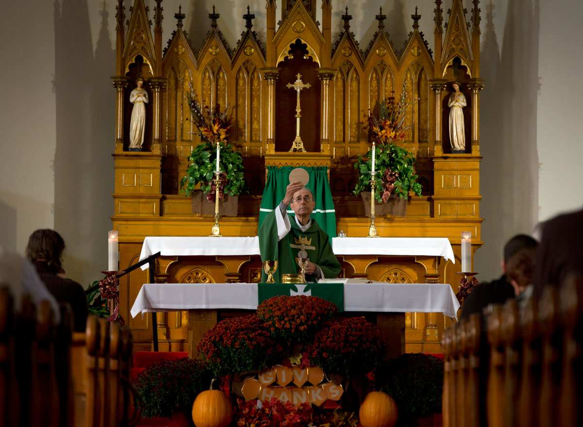 Father Roy Kiggins celebrates Communion during Mass at St. Mary Church in Waterloo Oct. 12.