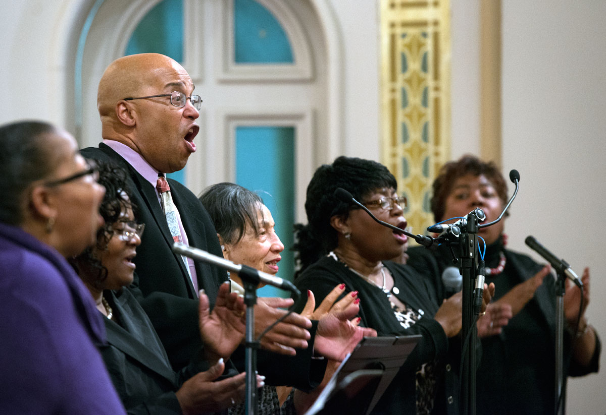 "Choir members sing the opening hymn, ""I'm Sanctified,"" during the second night of the Black Catholic Revival Nov. 14, hosted by the Diocese of Rochester at Rochester's Immaculate Conception/St. Bridget's Church."