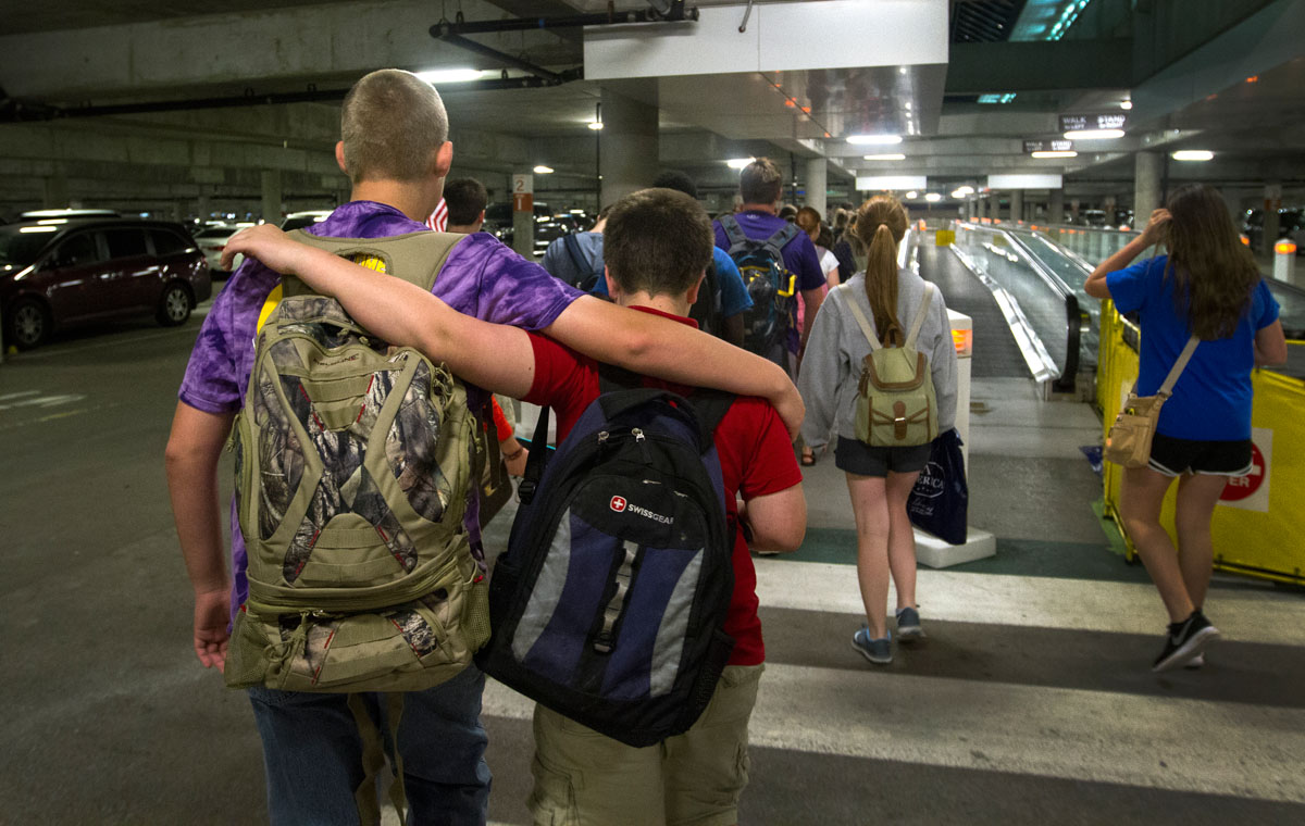 Tyler Thomas (left) of Bowling Green and Scott Tobe of Louisville walk through a parking garage at the Nashville International Airport after returning from a day-long field trip to Washington D.C. Tuesday, June 30. (Photo by Sam Oldenburg)