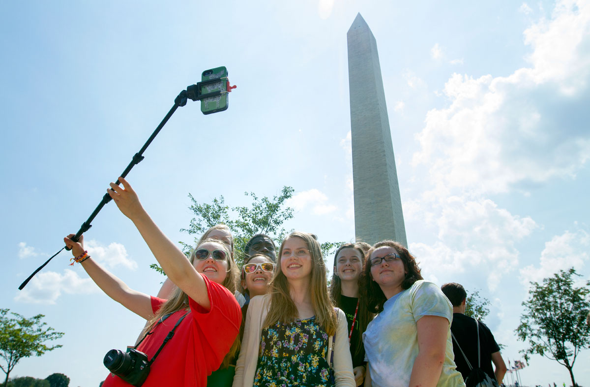 Pop Culture students take a selfie in front of the Washington Monument during a field trip to Washington D.C. Tuesday, June 30.