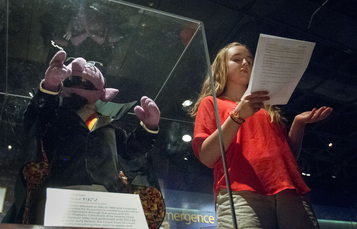 Madison Fleischaker of Louisville gives a report on Sesame Street's Count Von Count at the National Museum of American History in Washington, D.C., Tuesday, June 30.