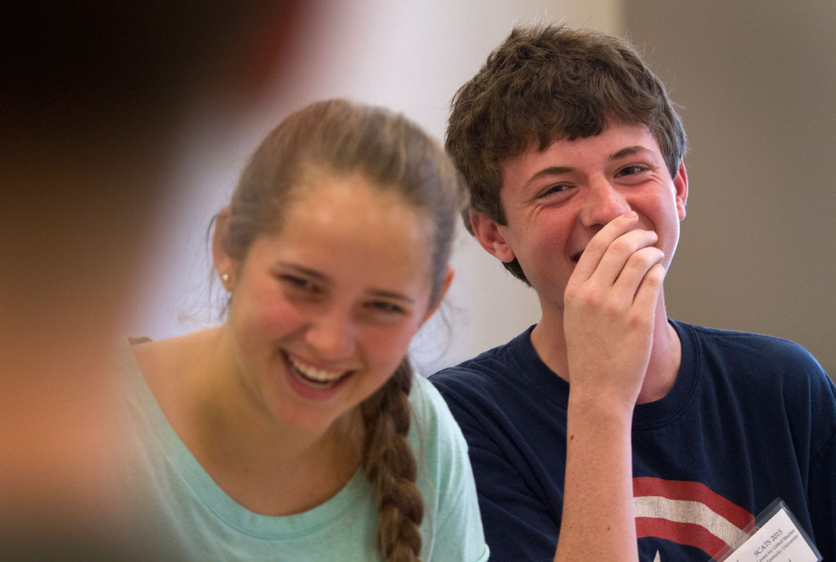 "Mary Baker of Paducah and Jared Rodgers of Verona laugh after Jared flubbed a line while rehearsing for ""12 Angry Pigs,"" a parody of ""12 Angry Men"" June 11 in Acting class June 10."