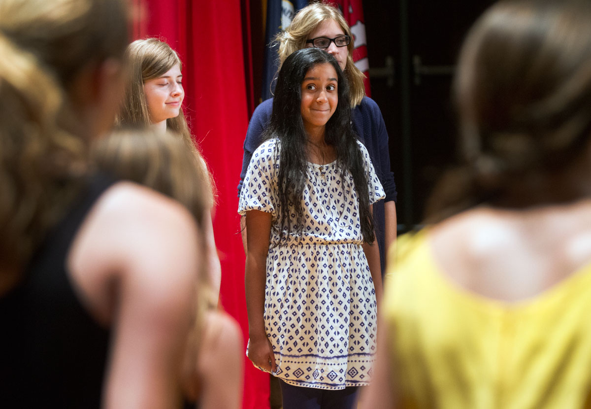 Shruit Gautam of Bowling Green wait for the right moment to start singing during the Musical Troupe performance after the SCATS Banquet Thursday, June 18.