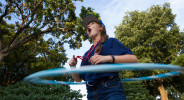 Chloe Banaszak of Crestwood hula hoops behind Northeast Hall during Mandatory Optionals Tuesday, June 28.