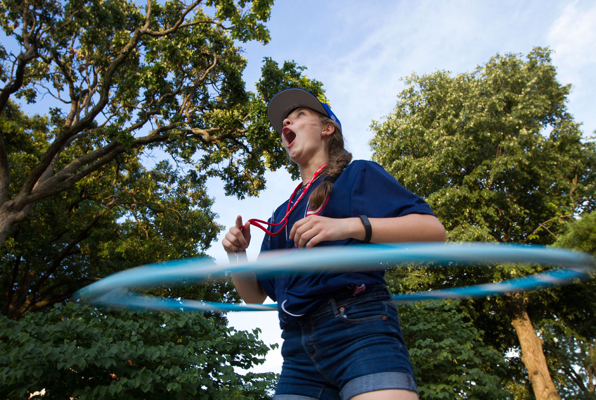 Chloe Banaszak of Crestwood hula hoops behind Northeast Hall during Mandatory Optionals Tuesday, June 28.