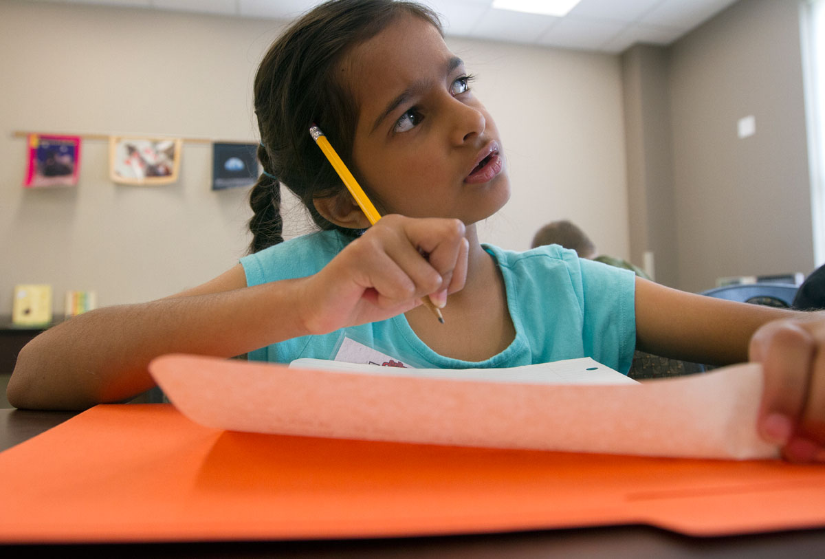 Anjali Gaba ponders her story while writing it out during Language Arts Monday, July 11.