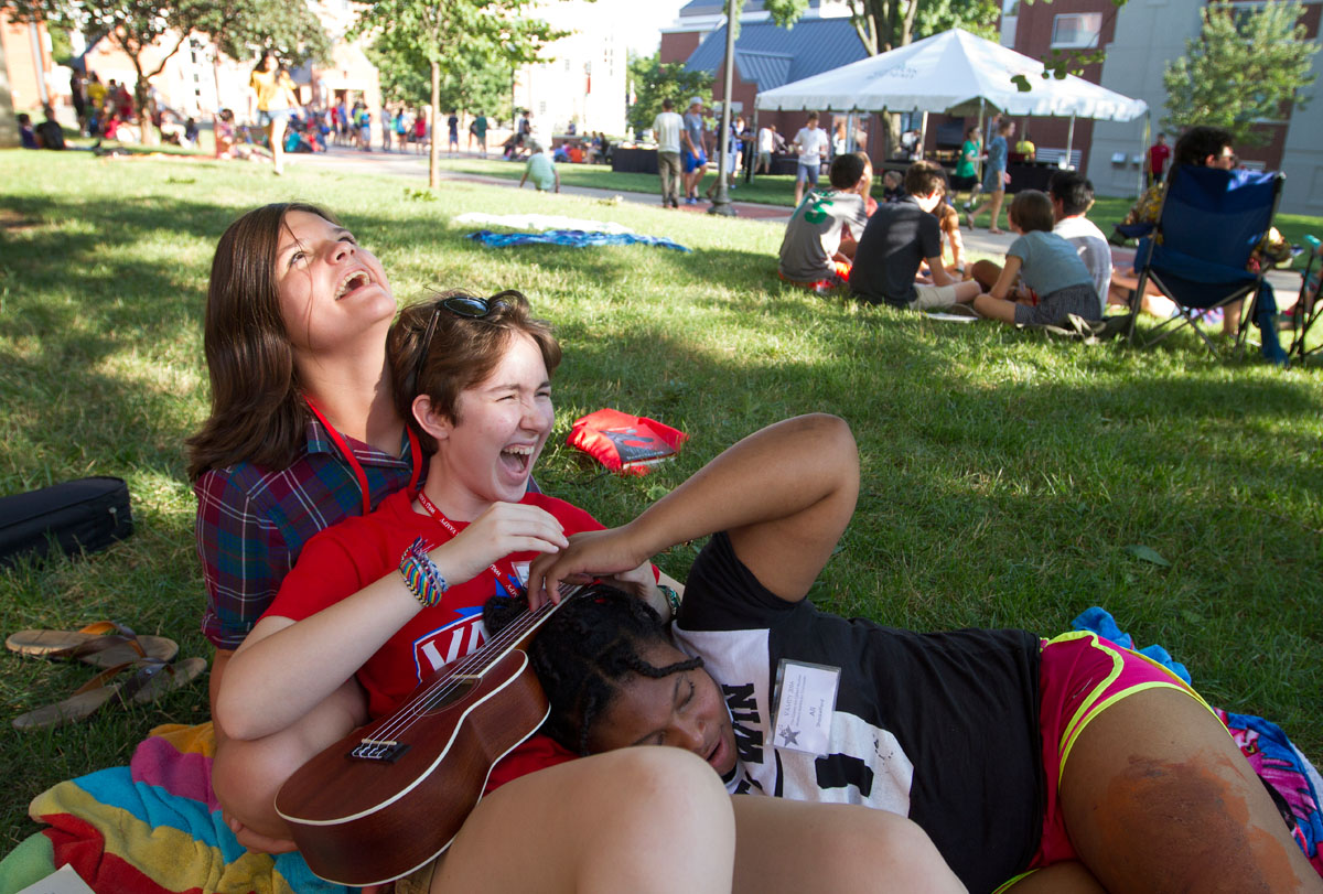 Laine Hirn (from left) of Louisville, Zoe Ward of Frankfort, and Ali Shackelford of Louisville share a laugh during the cookout Sunday, July 10.