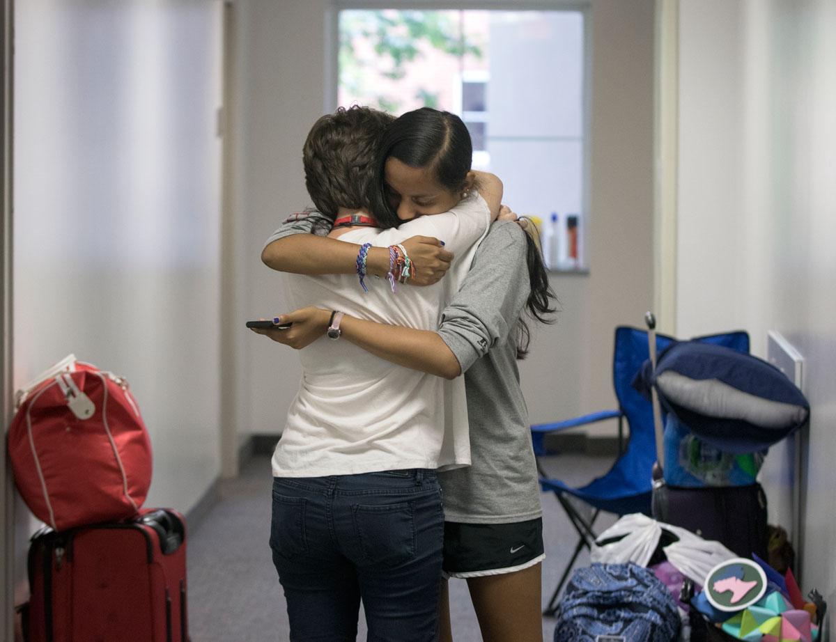Kyra Morgan (left) of Berea and Amirta Manikandan of Cordova, Tenn., hug goodbye after packing up their belongings during checkout Saturday, July 16.